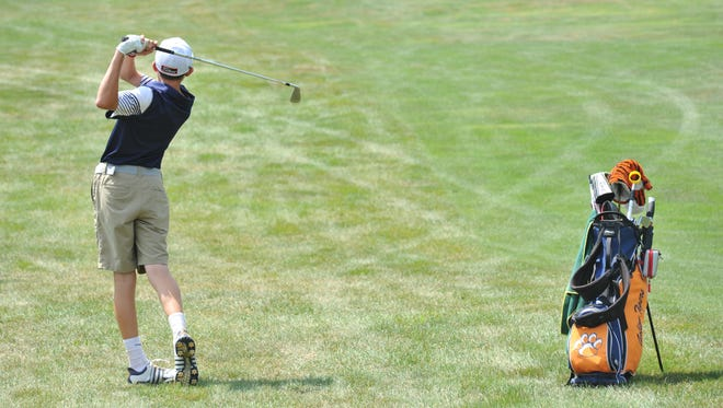 Galion's Matt McMullen hits onto the green from the fairway of the 17th hole at The Golf Club of Bucyrus.