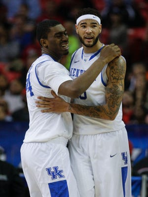 Kentucky's Dakari Johnson hugs teammate Willie Cauley-Stein as the Wildcats' win over LSU was assured Friday in Atlanta. March 14, 2014.