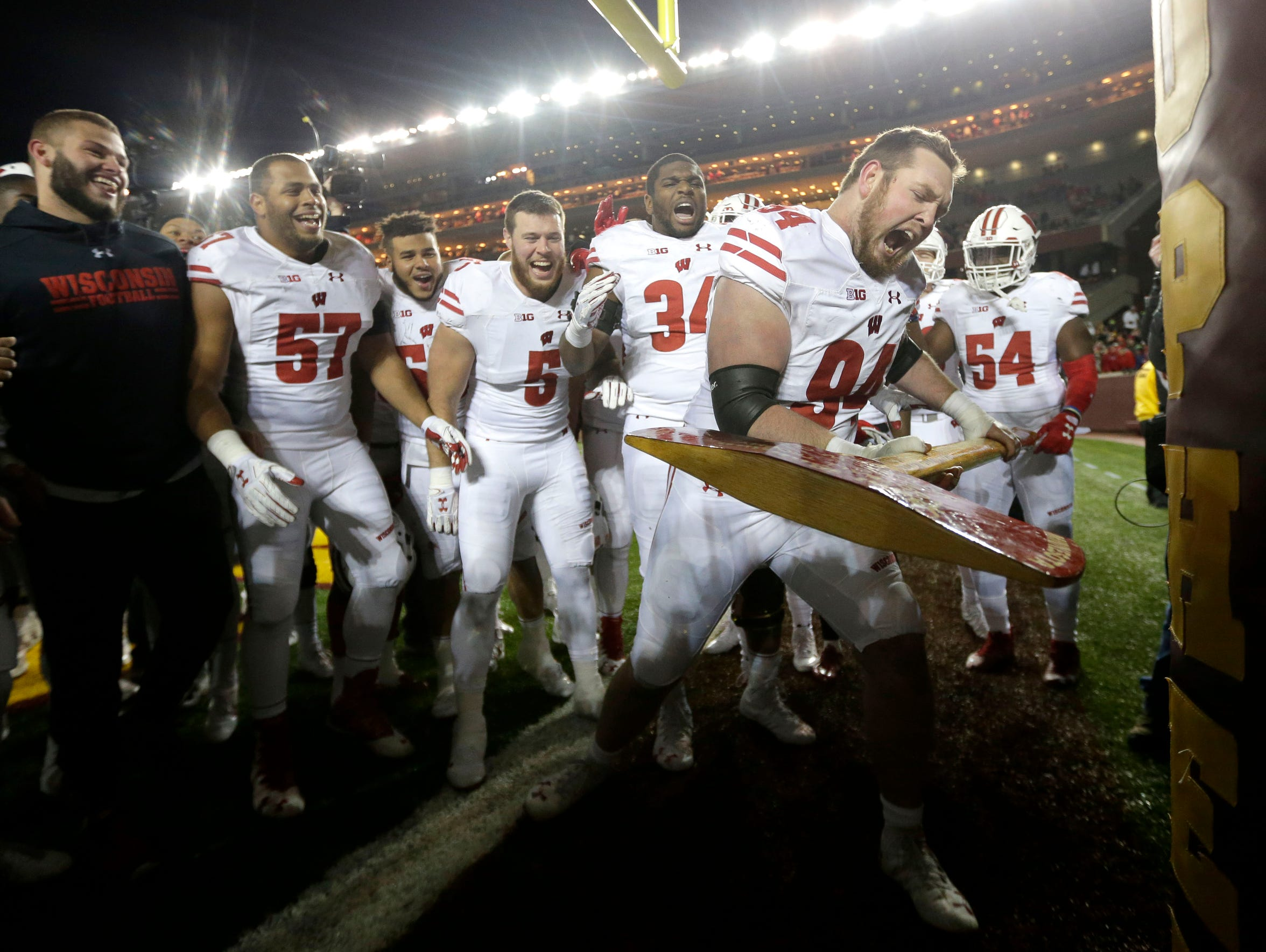 Wisconsin Badgers defensive end Conor Sheehy imitates chopping down the goal post after UW's 31-0 victory over Minnesota on Saturday, Nov. 25. It was the Badgers' 14th straight win over Minnesota.