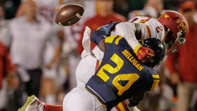 Toledo free safety Rolan Milligan (24) forces Iowa State running back Mike Warren (2) to fumble the ball during the second quarter of an NCAA football game Saturday, Sept. 19, 2015, at the Glass Bowl in Toledo, Ohio.