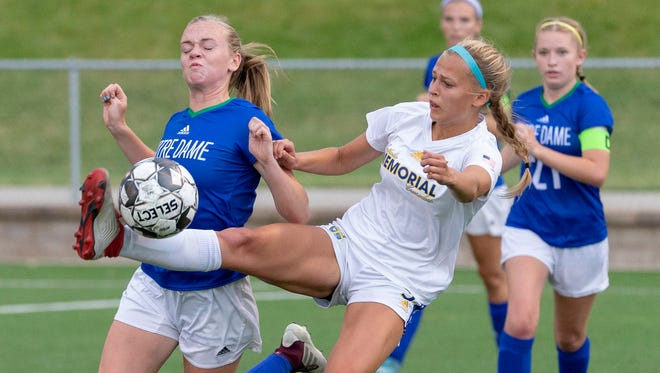 Catholic Memorial midfielder Jenny Fuller stretches for the ball in front of Notre Dame midfielder Jenna Cuene in the Division 1 championship game Saturday.