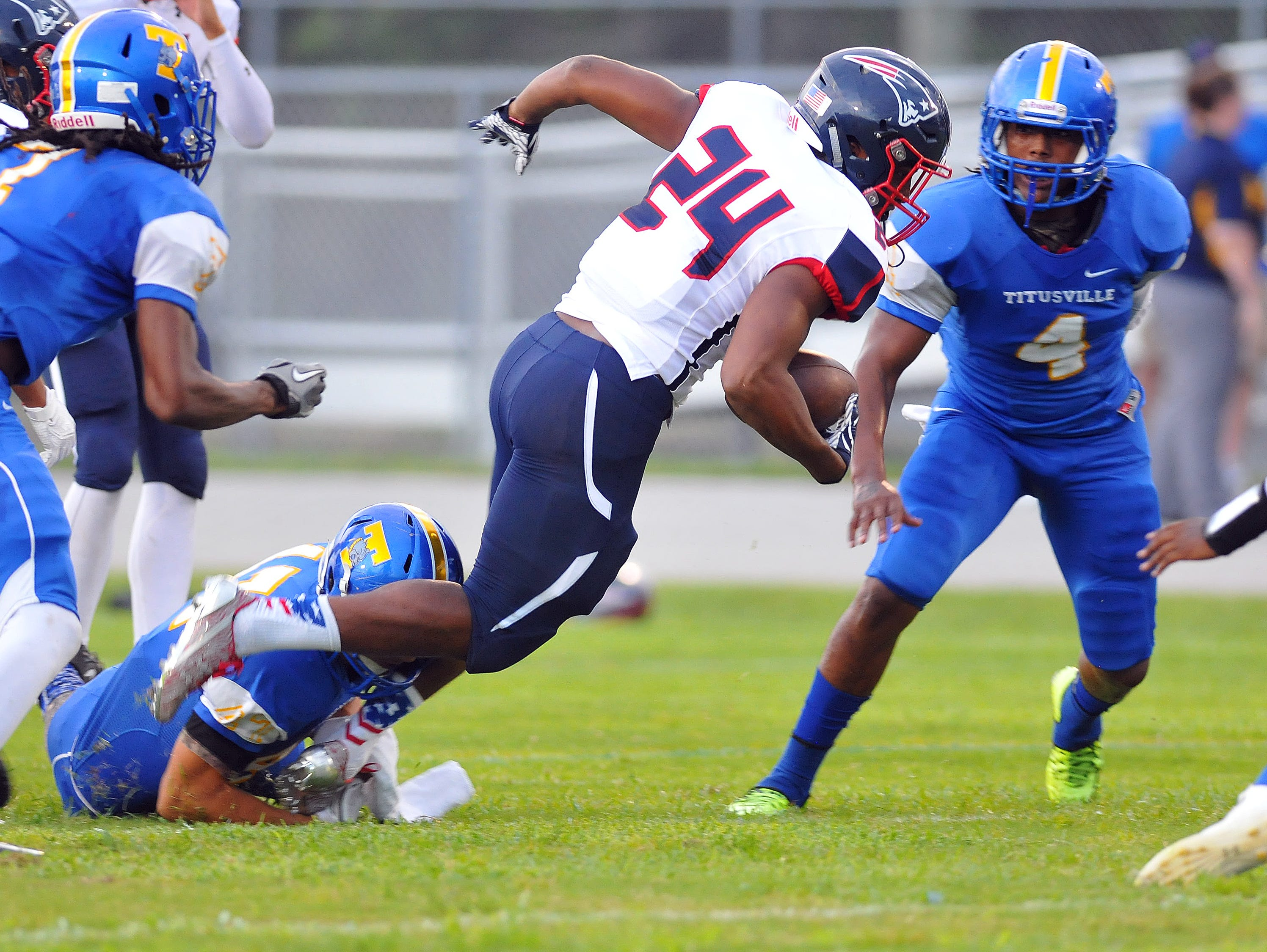 Titusville LB Bobby Bruce (4) closes in on a Lake Brantley runner.
