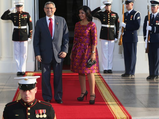 WASHINGTON, DC - AUGUST 05: Cabo Verde President Jorge Carlos de Almeida Fonseca and spouse Lígia Arcângela Lubrino Dias Fonseca arrive at the North Portico of the White House for a State Dinner on the occasion of the U.S. Africa Leaders Summit, August 5, 2014 in Washington, DC. African leaders are attending a three-day-long summit in Washington to strengthen ties between the United States and African nations.  (Photo by Mark Wilson/Getty Images)