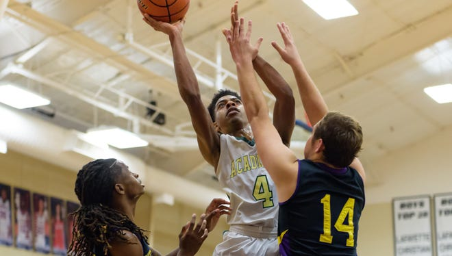 Devin Anderson takes it to the basket as Acadiana faces off against Westgate in the first round of the LCA basketball tournament. Wednesday, Dec. 20, 2017.