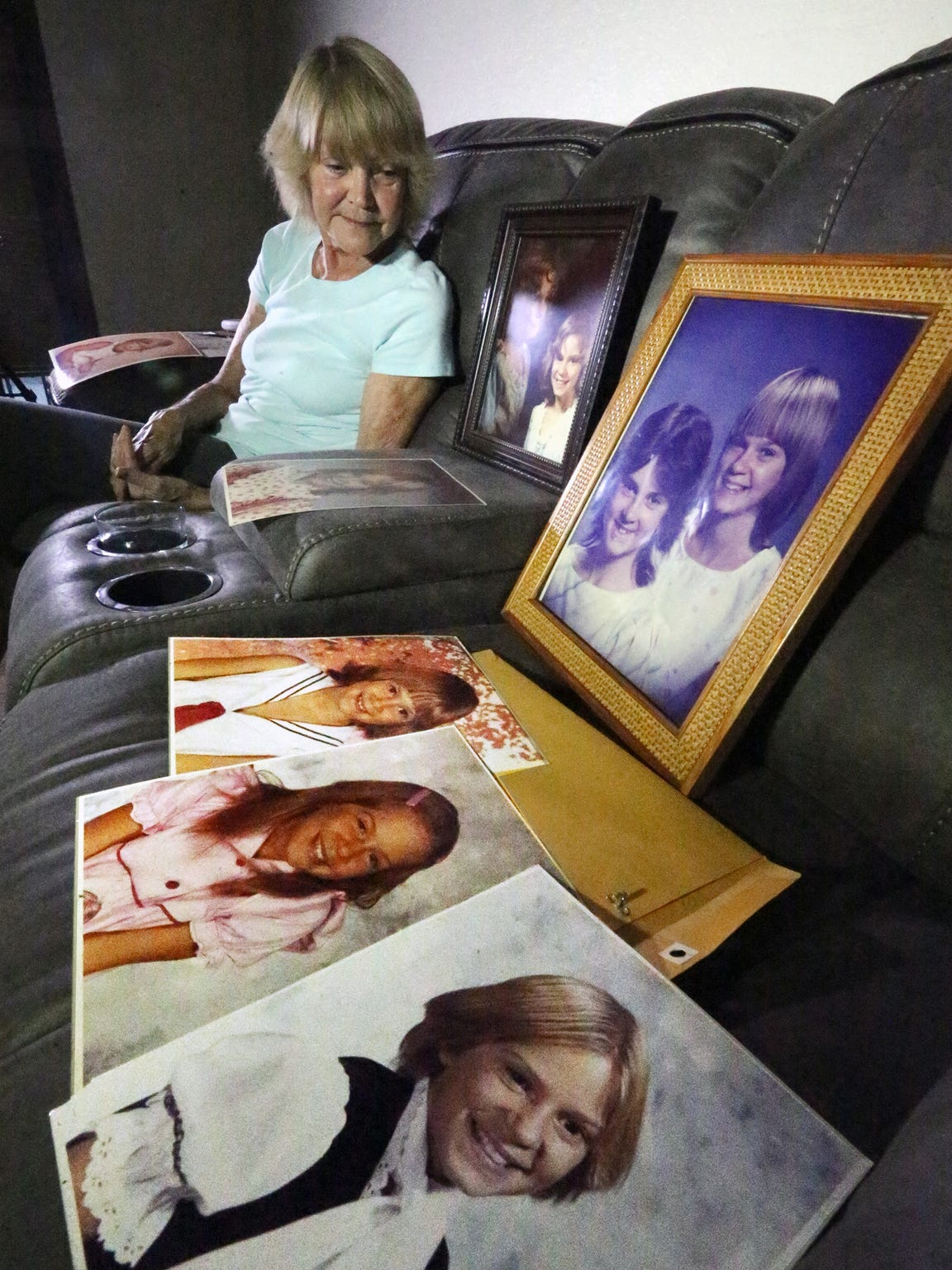 Marcia Fulton with photos of her daughter Desiree Wheatley in the living room of her West El Paso home.