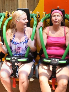 2014: People get ready to try out the thrill ride Zumanjaro Drop of Doom.