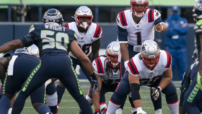 New England Patriots quarterback Cam Newton (1) audibles at the line of scrimmage during the first half Sunday night's game against the Seattle Seahawks in Seattle.