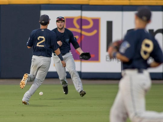 Jamie Westbrook (8) watches as Sebastian Elizalde's hit falls between (2) and (12) during the Mobile BayBears vs. Blue Wahoos baseball game one of a double header at Blue Wahoos Stadium in Pensacola, FL on Thursday, June 16, 2016.