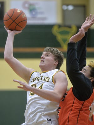 CMR's Sam Vining shoots in a game earlier this season. Vining dropped a game-high 21 points in the Rustlers' victory over Butte Saturday.