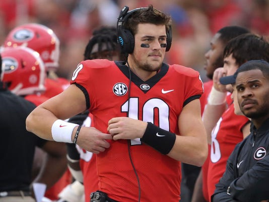 """FILE - In this Nov. 18, 2017, file photo, Georgia quarterback Jacob Eason (10) stands along the sideline during the first half of the team's NCAA college football game against Kentucky in Athens, Ga.  Eason said Friday, Jan, 12, he is leaving Georgia, an expected decision after he lost his starting job to freshman Jake Fromm. Eason made the announcement on his Twitter account. """"Thank you UGA for an incredible two years,"""" he wrote. """"The memories and relationships I have made will truly last a lifetime. I will miss suiting up in red and black, but Athens will always be a place I can call home."""" (AP Photo/John Bazemore, File)"""