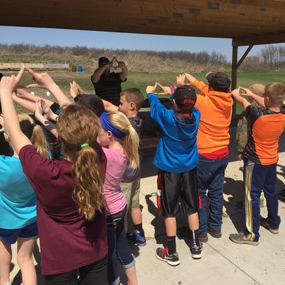 State DEC Police Officer Brian Wade teaches youngsters