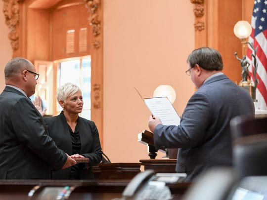 President Larry Obhof administers the Oath of Office to retired Lt. Suzanna Dawson, of Granville, who will now serve on the Ohio Senate's Sergeant at Arms team.