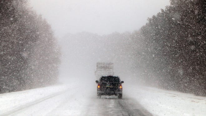 Vehicles move along a snow and ice covered Interstate 26, near Savannah, Ga. on Jan. 3, 2018. A brutal winter storm dumped snow in Tallahassee, Fla., on Wednesday for the first time in nearly three decades before slogging up the Atlantic coast and smacking Southern cities such as Savannah and Charleston, South Carolina, with a rare blast of snow and ice.