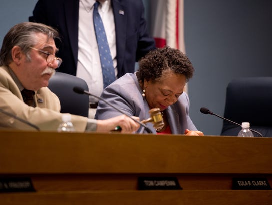 Stuart City Commissioner Eula Clarke (center), who earlier resigned as mayor, bows her head as newly-appointed Mayor Tom Campenni calls for order during a public comment session at a city commission meeting Wednesday, Feb. 1, 2017, at Stuart City Hall. Campenni subsequently resigned as mayor, and later as commission, in the wake of allegations against him.