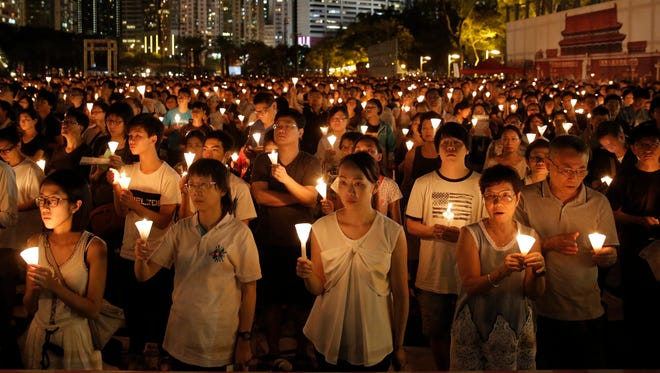 Tens of thousands of people attend a candlelight vigil at Victoria Park in Hong Kong on June 4, 2016, to commemorate victims of the 1989 military crackdown in Beijing. China's bloody crackdown on the Tiananmen Square pro-democracy protests was a pivotal moment in the country's political development.
