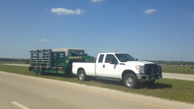 The Sheriff's Department of Agriculture Unit is responding after a landowner was arrested by Lee County Sheriff's Office for not take care of the cattle correctly.