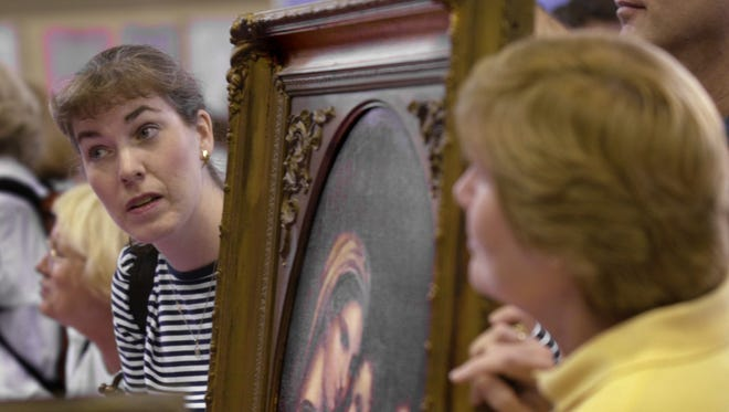 """Thousands of people brought their antiques to the Indiana Convention Center to get appraisals during a 2001 """"Antiques Roadshow"""" tour stop."""