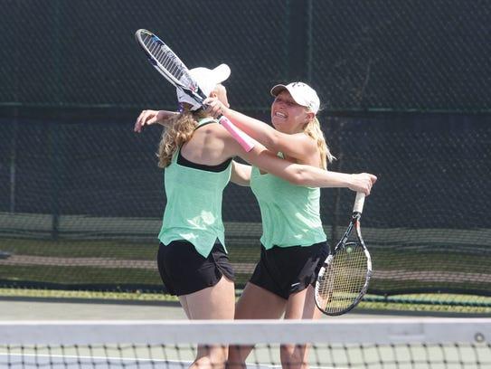 Iowa City West's Abby Jans, right, and Emma Koch celebrate