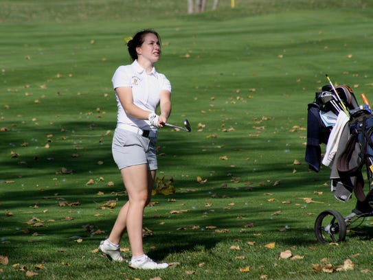 Saline senior Molly Pribble chips to the 9th green