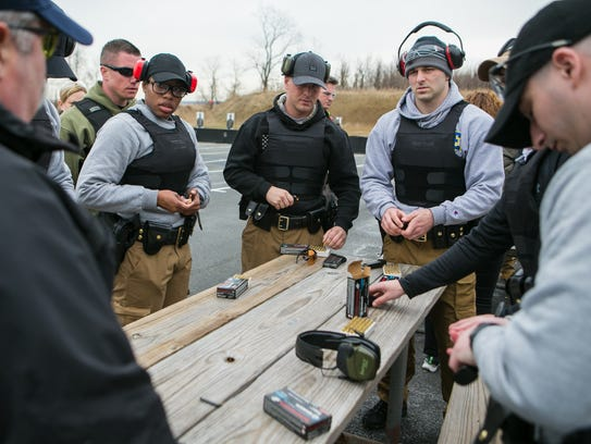 New Castle County Police recruits load their magazines