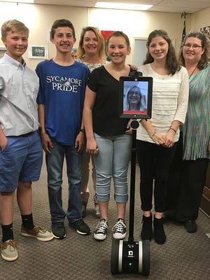 Sycamore Middle School students Amanda Belt, Kaleb Nickens, Houston Hudspeth and Railyn Brooksher are pictured with teacher Beth Stokes and assistant principal Robyn Miller and Alpha, the new robot. Not pictured is student Cameron Trail.