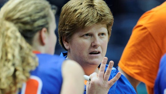 Livonia coach Karen Schuster talks to her team in a