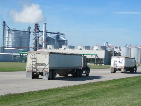 Grain trucks arrive at Absolute Energy, an ethanol