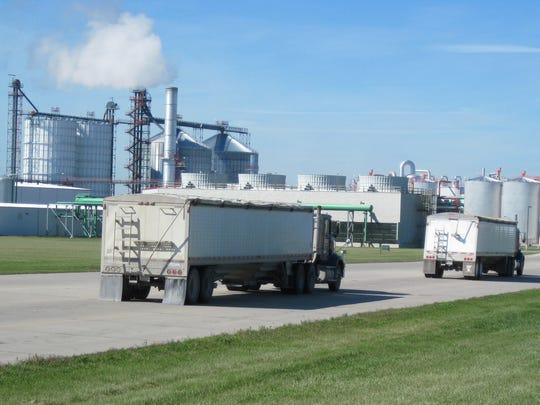 Grain trucks arrive at Absolute Energy, an ethanol