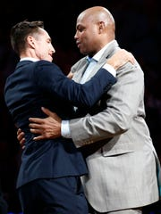 Former Suns point guard Steve Nash is hugged by Charles