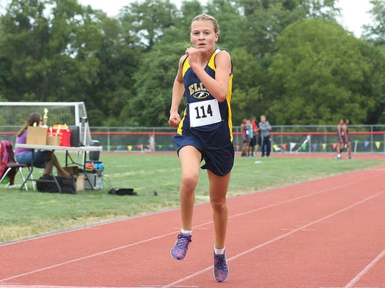 Lily Brubaker of Elco heads to the finish line to win the girls race at the Lebanon County Cross Country Championships.