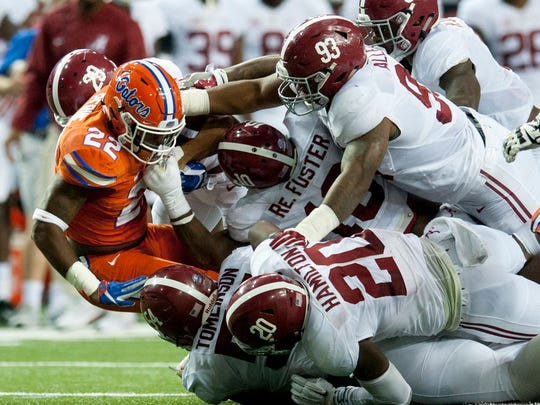 Florida running back Lamical Perine (22) found out firsthand how dominant Alabama's defense was last season.