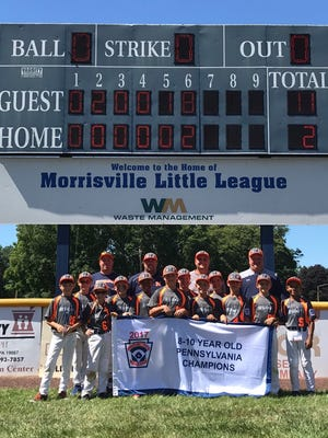 Northeastern Little League poses with its championship banner after its 11-2 win over East Pennsboro on Sunday.