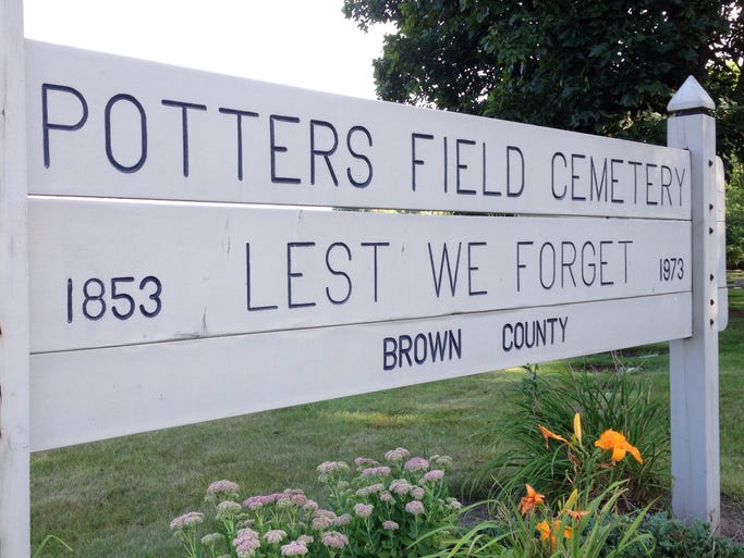 Brown County erected this sign overlooking a state highway that passes near Potters Field Cemetery.