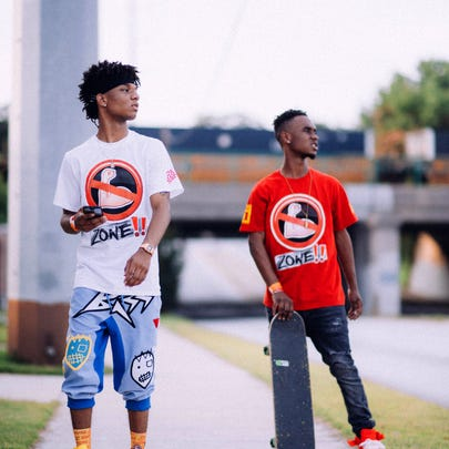 Rappers Swae Lee, left, and Slim Jimmy perform as Rae