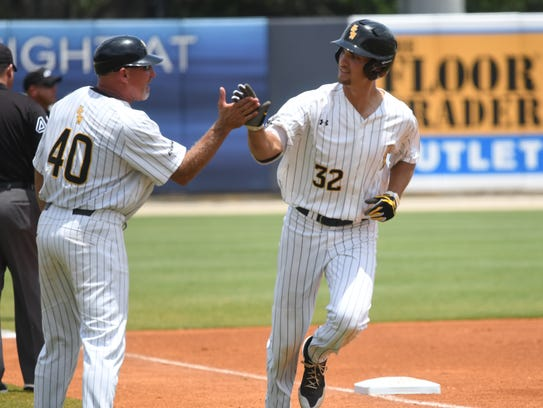 Southern Miss' Matt Wallner is congratulated by coach