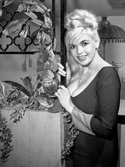 Actress Jayne Mansfield gives an interview in her Cordell