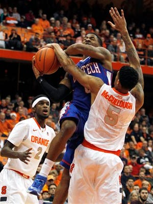 Louisiana Tech's Alex Hamilton, center, shoots under pressure from Syracuse's B.J. Johnson, left, and Chris McCullough, right, during their game earlier this month.