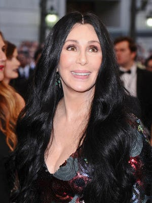 In this May 4, 2015 file photo, Cher arrives at the Metropolitan Museum of Art's Costume Institute benefit gala in New York. Cher has sued a financial management firm she claims defrauded her out of more than $800,000 in investments that went belly-up. The suit was filed Wednesday, June 8, 2016 in Los Angeles County Superior Court on behalf of Veritas Trust, of which the singer is the sole trustee.