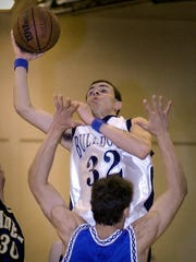 Quinn Howard is seen in this 2003 file photo driving to the basket in a York and Lancaster all start game. Howard and his wife, Sade Howard, are expecting a boy, Quinn Jr., in March.