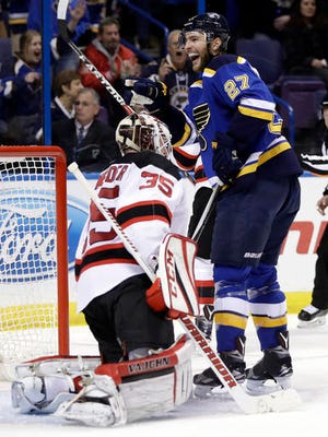 St. Louis Blues' Alex Pietrangelo (27) smiles after scoring past New Jersey Devils goalie Cory Schneider during the second period of an NHL hockey game Thursday, Dec. 15, 2016, in St. Louis.
