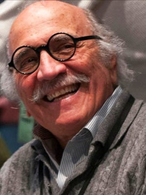 This undated photo provided by courtesy of Cuyahoga Community College shows Grammy-winning jazz and pop producer Tommy LiPuma. LiPuma died Monday, March 13, 2017, in New York at age 80 after a brief illness, according to the Decca/Verve Label Group, where he had served as chairman. In a career spanning six decades, LiPuma's productions won five Grammys and sold 75 million copies.