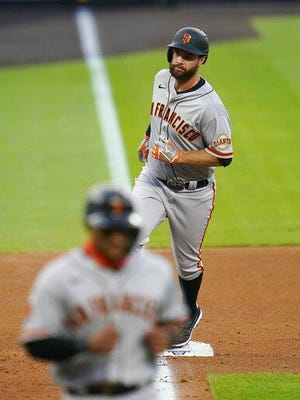 San Francisco's Brandon Belt rounds the bases after hitting a three-run home run against Colorado during the fourth inning on Wednesday at Coors  Field in Denver.