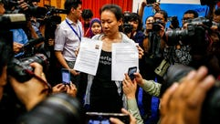 The wife of a missing Malaysia Airlines Flight MH370