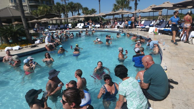 People play in the pool and on the sand after last year's Greater Tallahassee Chamber of Commerce Annual Conference at the Ritz-Carlton at Amelia Island Saturday, Aug. 20, 2016.