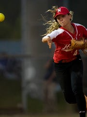 North Fort Myers' Haley Weaver throws towards first base during the Class 6A regional semifinal against Barron Collier Tuesday, May 9, 2017. North Fort Myers would win 8-4.