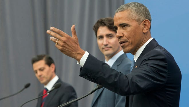 President Obama, accompanied by Canadian Prime Minister Justin Trudeau and Mexican President Enrique Pena Neito, speaks during their trilateral news conference for the North America Leaders' Summit at the National Gallery of Canada in Ottawa Wednesday.
