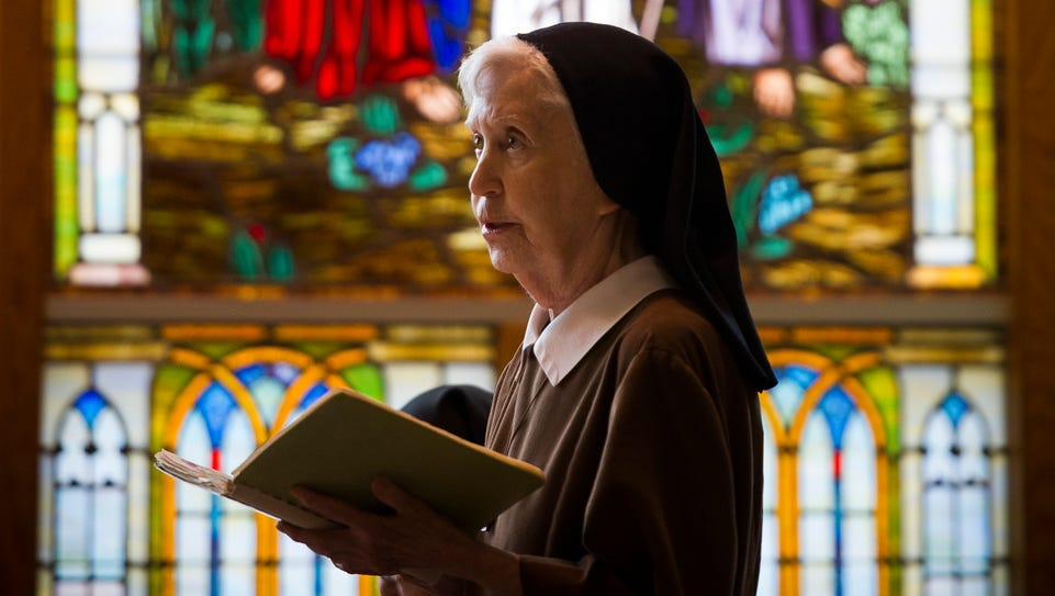 Sister Jane Marie DeLand stands during the daily Office