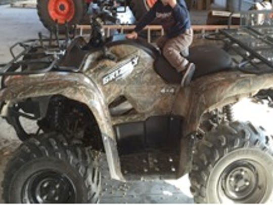 2008 Yamaha Grizzly 700 Camo with a front double gun rack and extended rear rack.