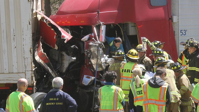 Brewster and Croton Falls firefighters remove injured truck driver from his crushed cab following an accident involving two tractor trailer and two passenger cars on Interstate 684 in the town of Southeast April 24, 2016. It took firefighters about an hour to extricate the driver who was transported to the Westchester Medical Center by LifeNet helicopter.