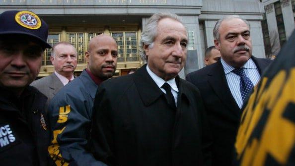 Bernard Madoff, center, walks out from federal court in Manhattan in January 2009.